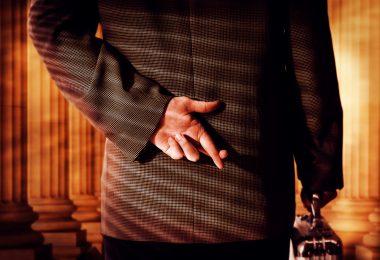 Businessman Crossing Fingers