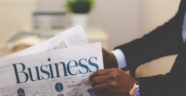 man-reading-business-paper