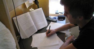 a student writing a critical book review