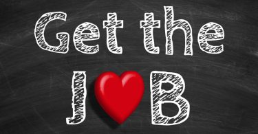 Text Get the job is written on the blackboard background with the letter o as a heart