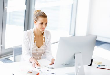 Attractive woman sitting at desk in federal office job