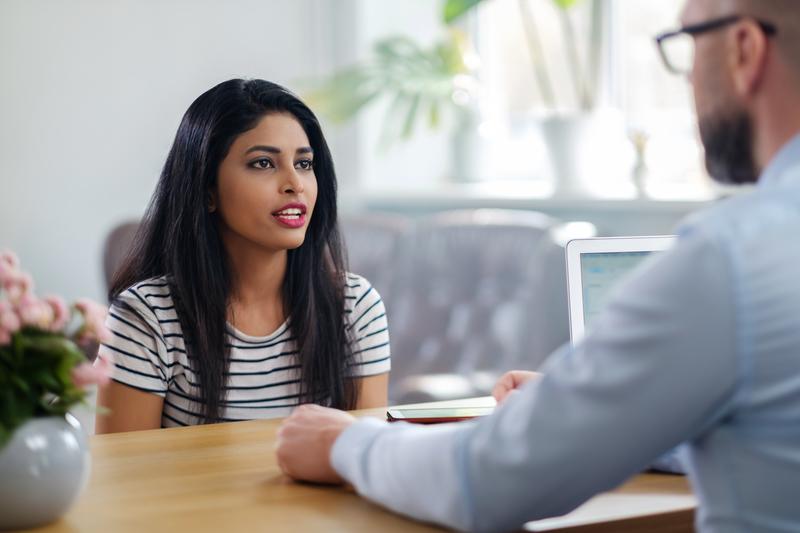 Indian girl attending job interview.