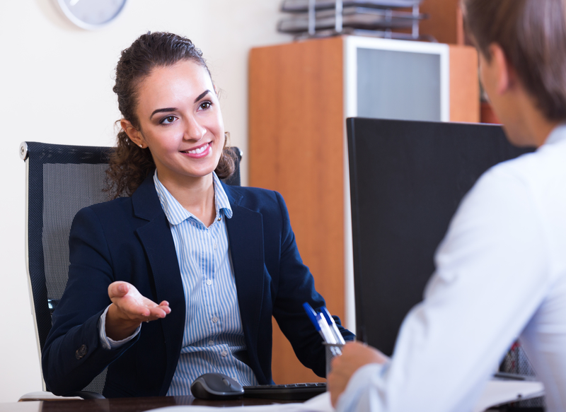 male employee having meeting with female manager in office