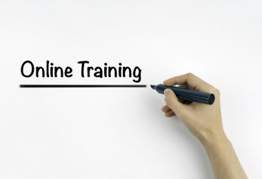 Hand with marker writing: Online Training