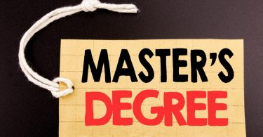 masters degree written on price tag paper on black vintage background