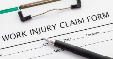pen on work injury claim document