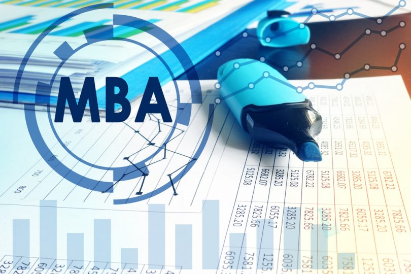 MBA letters over top desk with documents and blue highlighter