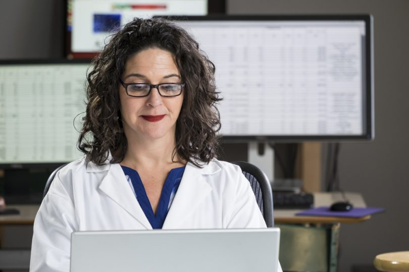 medical records technician working on computer
