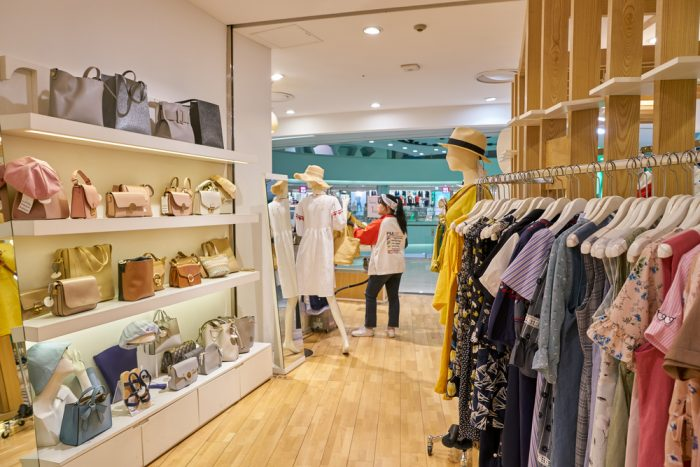 bright and colorful retail store with clothes and purses